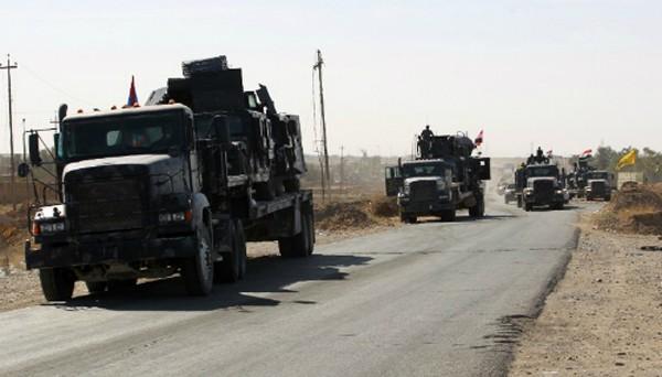 Lực lượng Iraq tại căn cứ quân sự Qayyarah, cách Mosul hơn 50 km về phía nam. Ảnh: AFP