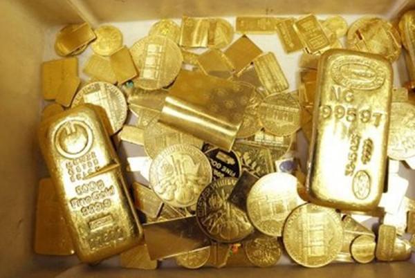 Giá vàng đang được hỗ trợ bởi nhiều thông tin tích cực. Ảnh: AFP