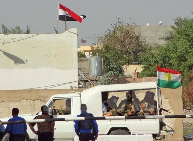 Lực lượng an ninh Iraq triển khai tại Kirkuk ngày 21/10 sau khi các tay súng IS tiến hành nhiều vụ tấn công liều chết tại thành phố này. (Nguồn: AFP/TTXVN)