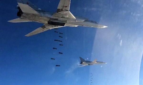 Không quân Nga ném bom vào phe khủng bố ở Syria. Ảnh: RT.