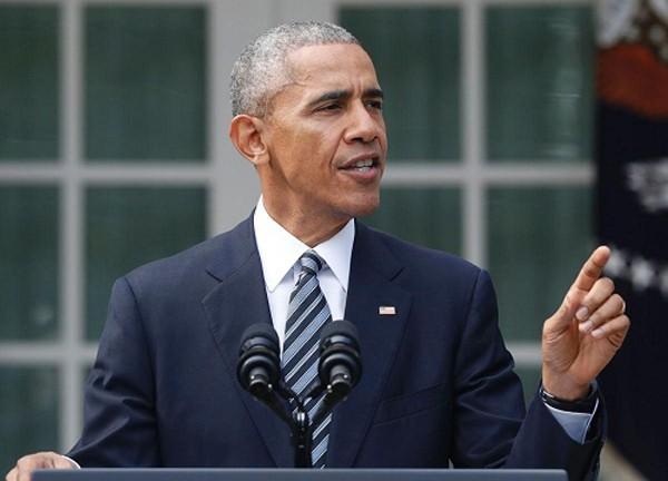 Tổng thống Obama hứa sẽ chuyển giao quyền lực trong hòa bình cho Trump. Ảnh: AP