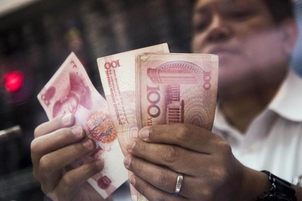 Các công ty Trung Quốc đang tích cực đổ tiền ra nước ngoài. Ảnh:Bloomberg