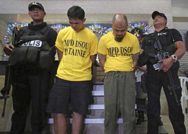 Hai nghi phạm âm mưu đánh bom công viên và sứ quán Mỹ ở Manila hồi đầu tuần. Ảnh:AP