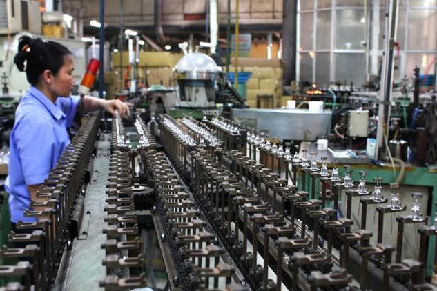 Doanh nghiệp Việt buộc phải đổi mới công nghệ để tăng sức cạnh tranh. Ảnh: Lê Tiên