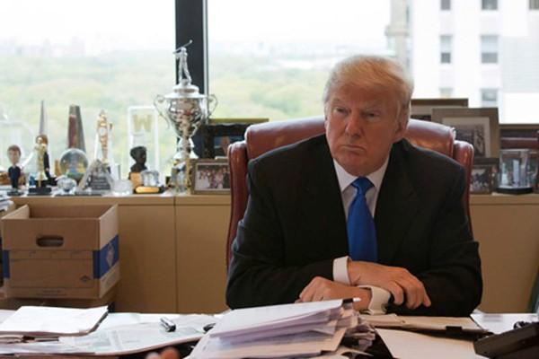 Ông Donald Trump đang chịu áp lực tách riêng việc kinh doanh và chính trị. Ảnh:AP