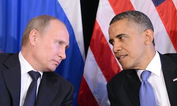 Tổng thống Nga Putin (trái) và Tổng thống Mỹ Obama trong một cuộc gặp năm 2012. Ảnh:AFP
