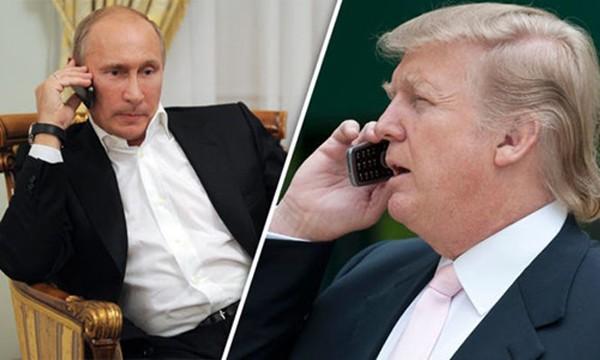 Tổng thống Nga Vladimir Putin và Tổng thống Mỹ Donald Trump. Ảnh:Daily Express.