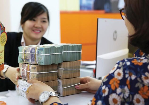 Để thúc đẩy tăng trưởng cần tăng tổng cầu của nền kinh tế với giải pháp cụ thể là tăng tín dụng đầu tư và tín dụng cho tiêu dùng. Ảnh: Lê Tiên