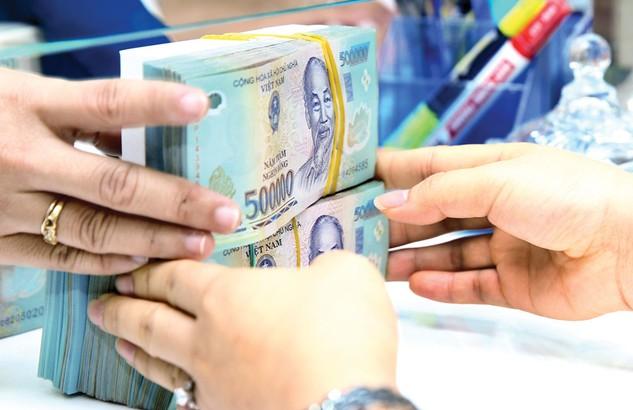 Dù ngành ngân hàng đã nỗ lực nhưng nợ xấu vẫn tiềm ẩn và hiện còn gần 600.000 tỷ đồng, tương đương 10,08% tổng dư nợ, đang cần xử lý. Ảnh: Lê Tiên