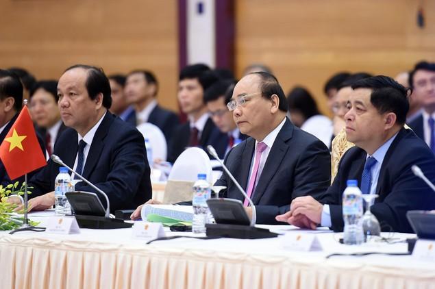 Lần đầu tiên Thủ tướng Việt, Lào chủ trì họp Ủy ban liên Chính phủ - ảnh 1