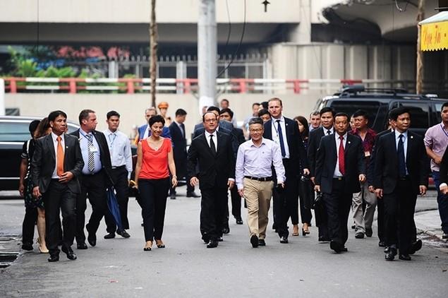 Một ngày của tổng thống Pháp tại Hà Nội - ảnh 7