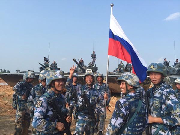Tập trận Biển Đông khó giúp 'tình một đêm' Nga - Trung thêm mặn nồng - ảnh 1