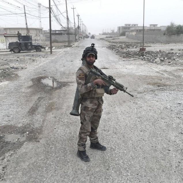 Những sắc áo chiến binh trong lực lượng giải phóng Mosul - ảnh 11
