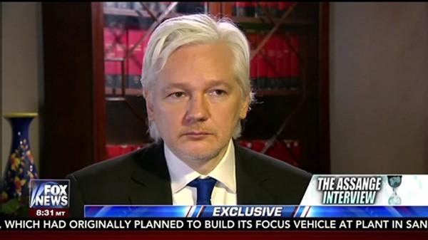Ông chủ WikiLeaks - tội đồ với Obama, người hùng với Trump - ảnh 1