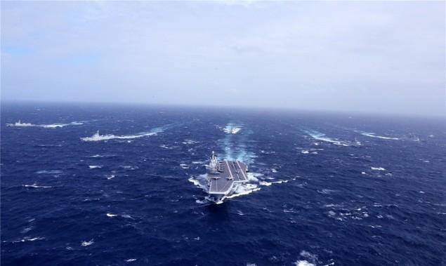 Trung Quốc công bố hình ảnh tàu sân bay diễn tập ở Biển Đông - ảnh 1