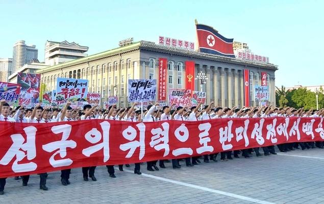 Biển người Triều Tiên phản đối lệnh trừng phạt của Liên Hợp Quốc - ảnh 6